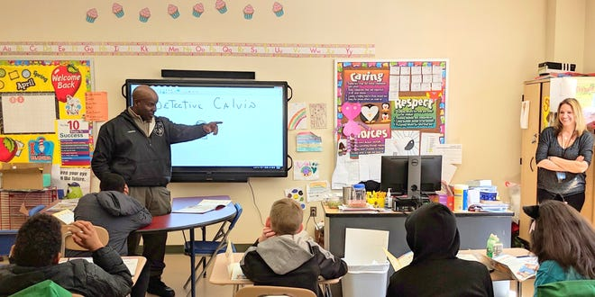 Piscataway Township Police Department Detective Calvin Laughlin introducing the D.A.R.E. program to NuView Academy students.