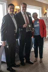 United Way Board President Brad Muller and CEO Bonnie Duncan presented Steve Croghan with this year's Sustained Volunteer Award.