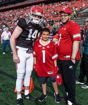 Rutgers Freshman Quarterback Cole Snyder (left) poses for a photo with Tommy Marcketta (middle) and Lamont Banks (right).