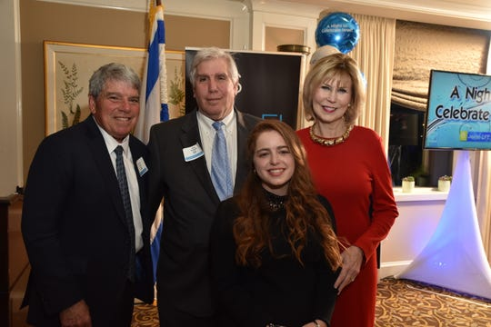The 7th Annual A Night to Celebrate Israel, sponsored by Jewish LIFE — a community wide adult education program — and Israel Bonds was held Thursday, April 11, at Raritan Valley Country Club in Bridgewater. The evening was held in support of Israel Bonds and the State of Israel. (Left to right) Gerald Ostrov, guest Presenter with the website, Peter Horowitz, chair of A Night to Celebrate Israel; Elisheva Strauss, Rutgers Hillel student and honoree; and Linda Bowden, NJ regional president, PNC Bank and honoree.