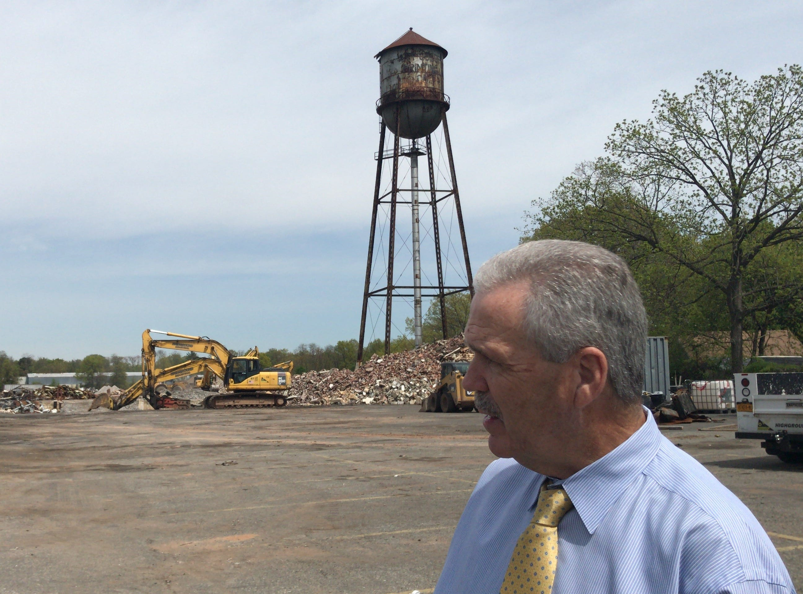 Dunellen Mayor Robert J. Seader stands in front the demolished Art Color plant on South Washington Avenue that soon will be redeveloped into Dunellen Station, a multi-use property that will consist of  252 apartments, 130 townhouses and 9,200-square-feet of retail.