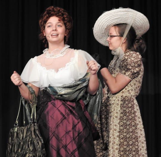 """Sam Corbett and Natalie Kelly rehearse a scene from """"Hello, Dolly!"""" playing Friday and Saturday at River View High School. Corbett stars as the title character matchmaker seeking a husband of her own in the classic Broadway musical."""