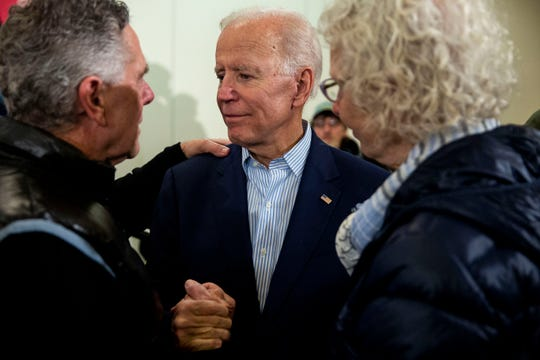Nic and Margie Gindorff of Dubuque talk to former Vice President Joe Biden about the death of their son to cancer after his speech at the Grand River Conference Center on April 30 in Dubuque. It was Biden's first trip to Iowa after announcing his run for president.
