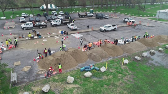 An aerial view shows volunteers and City of Detroit workers filling sand bags at the Alfred Brush Ford Park as requested by Detroit Mayor Duggan in a press conference to help protect flooding waters threatening the Jefferson Chalmers area of Detroit Wednesday, May 1, 2019.