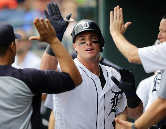 Detroit Tigers catcher James McCann high fives temmates after his homer against Tampa Bay pitcher Blake Snell during seventh inning action Wednesday, May 2, 2018, at Comerica Park in Detroit, Mich.