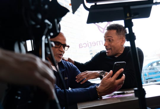 "Actor Hill Harper (right) is filmed talking with Matthew Evans of Grosse Pointe while doing promotion about ""Credit over Coffee"" as part of an effort to build credit scores through a new program called Experian Boost at his business the Roasting Plant Coffee in downtown Detroit on Wednesday, May 1, 2019."