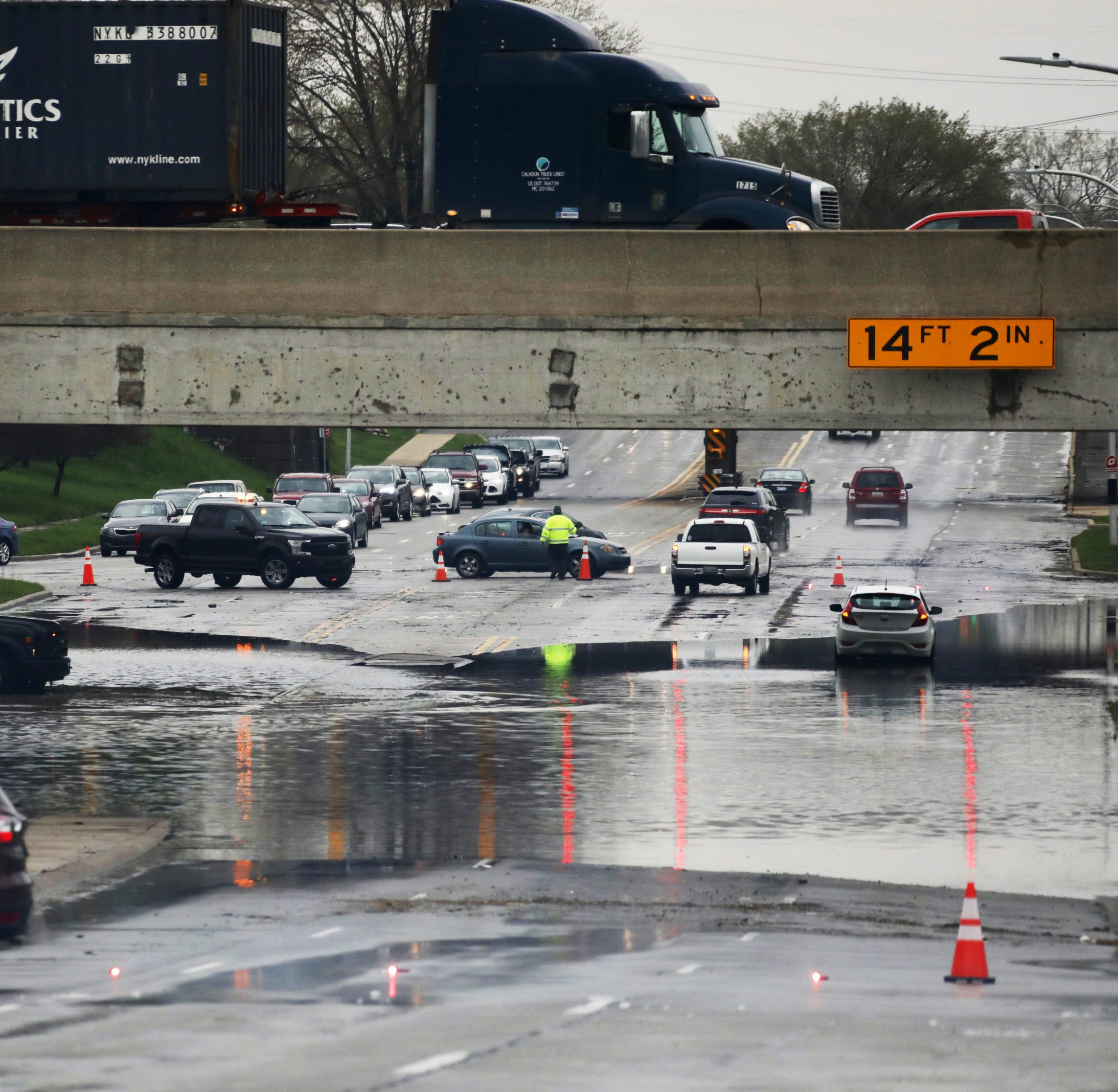 Trapped residents rescued by boat as Detroit, suburbs hit hard by flooding