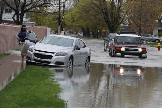 "Joanna Henderson of Inkster, a nurses aid, got stranded on Hamilton Avenue in Allen Park ""I got scared"" she said of the flooded waters in Allen Park Wednesday, May 1, 2019."