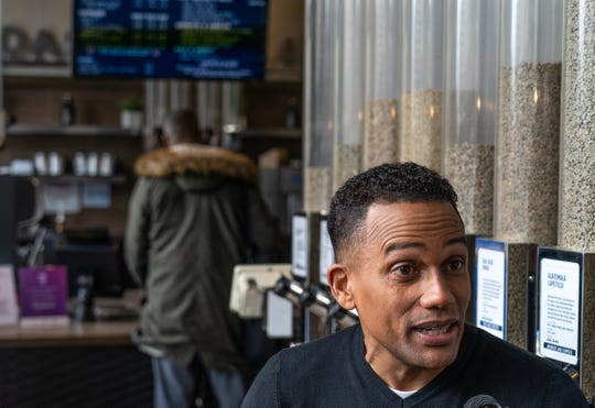 "Actor Hill Harper talks with a television reporter while doing promotion about ""Credit over Coffee"" as part of an effort to build credit scores through a new program called Experian Boost at his business the Roasting Plant Coffee in downtown Detroit on Wednesday, May 1, 2019."