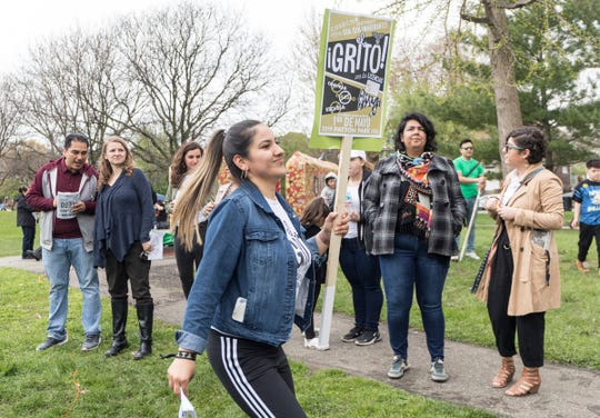 Cathy Gamboa, 25, of Detroit joins other protesters to rally for Michigan to grant all immigrants the right to get driver's licenses. The event took place at Clark Park in Detroit, Mich., Wednesday, May 1, 2019.