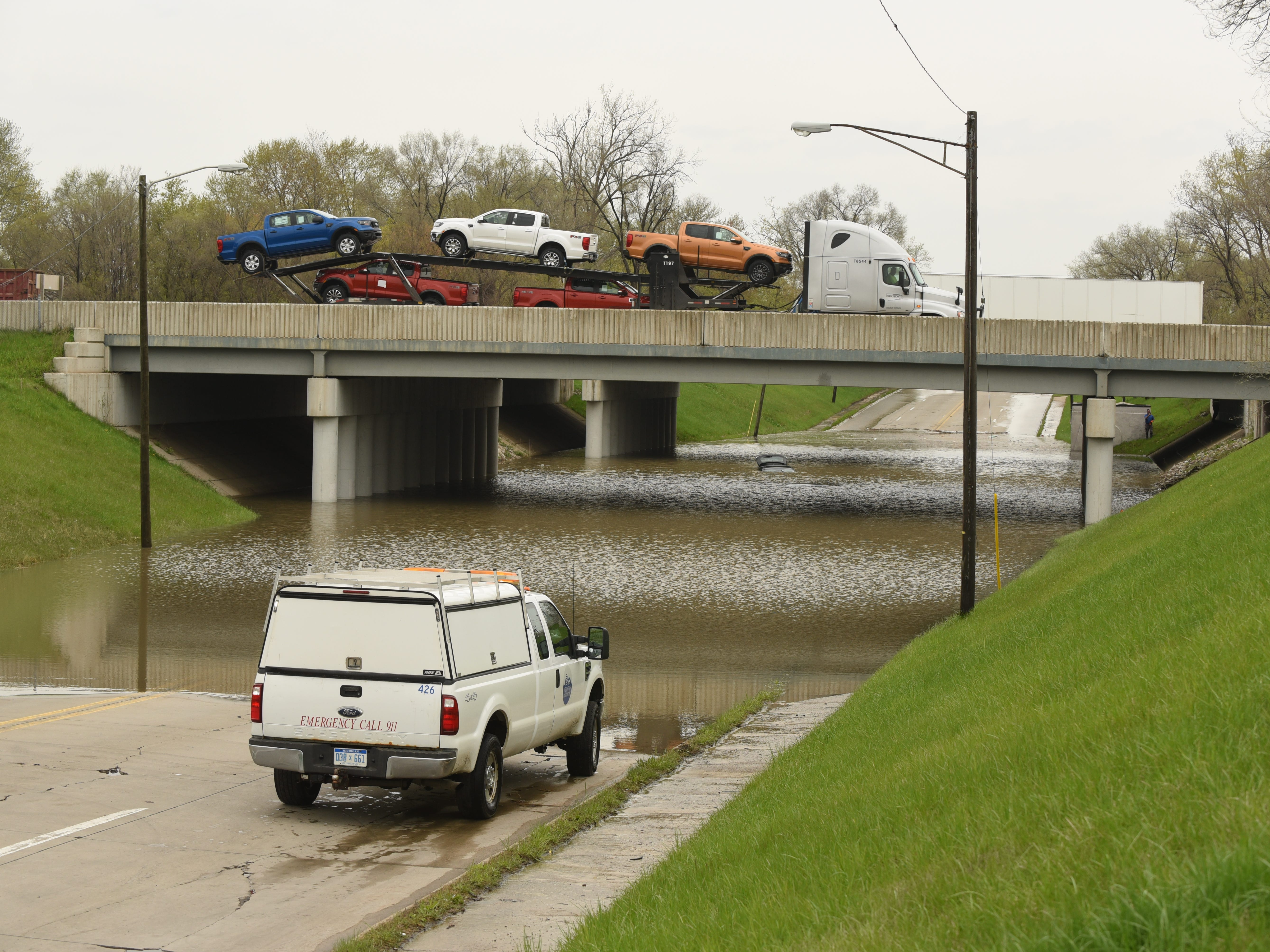 Motorists travel along I-94 above the flooded Monroe Blvd. underpass in Taylor.