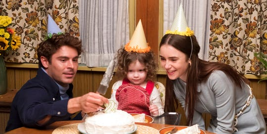 "This image released by Netflix shows Zac Efron, left, and Lily Collins, right, in a scene from ""Extremely Wicked, Shockingly Evil, and Vile."""