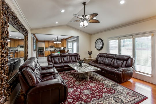 With 2,579 square feet, the two-story house has an open floor plan that flows into a family room with a fireplace that's sure to take the chill away on cold winter nights.