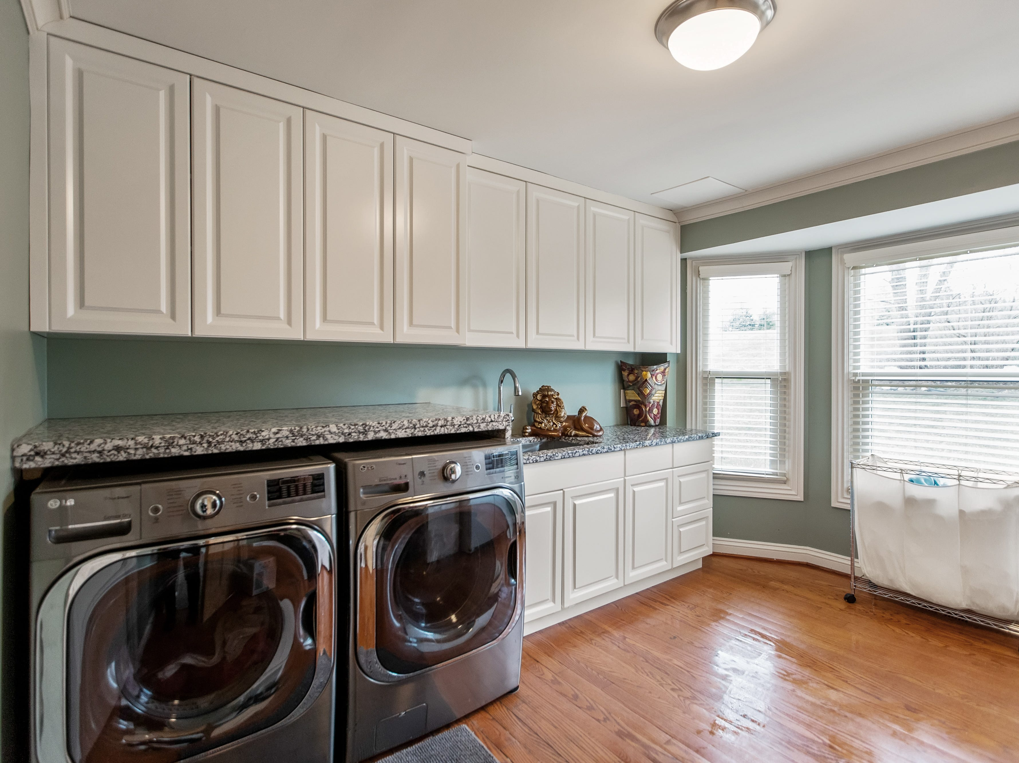 The first floor is designed with two laundry rooms, and the partially finished basement has 500 square feet of comfortable living space.