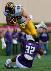 T.J. Hockenson (38) of Iowa was the John Mackey Award winner last season as the nation's top tight end. He was selected No. 8 overall by the Lions in the NFL Draft.