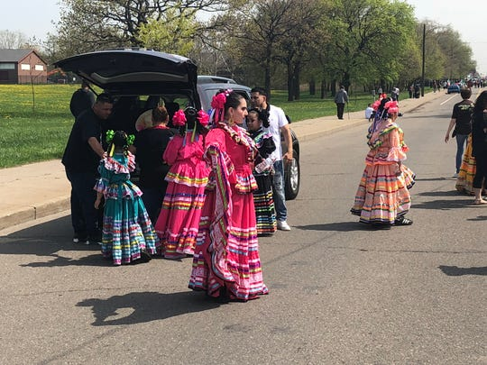 Dancers arrive for last year's Cinco de Mayo in southwest Detroit.
