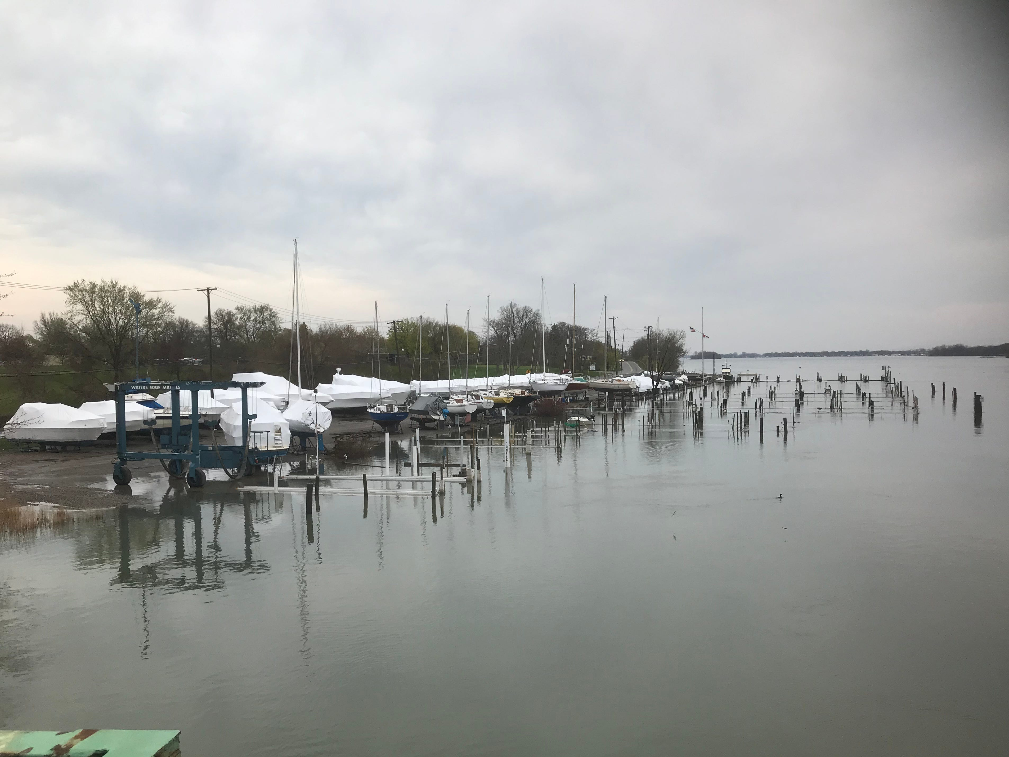 Water's Edge Marina's docks are under water in the Trenton Channel in Grosse Ile.