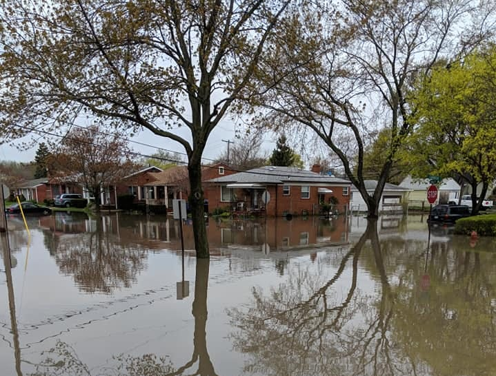 This is the view of the flooded neighborhood from the front porch of Dearnborn Heights resident Maria Rodriguez-Torres.