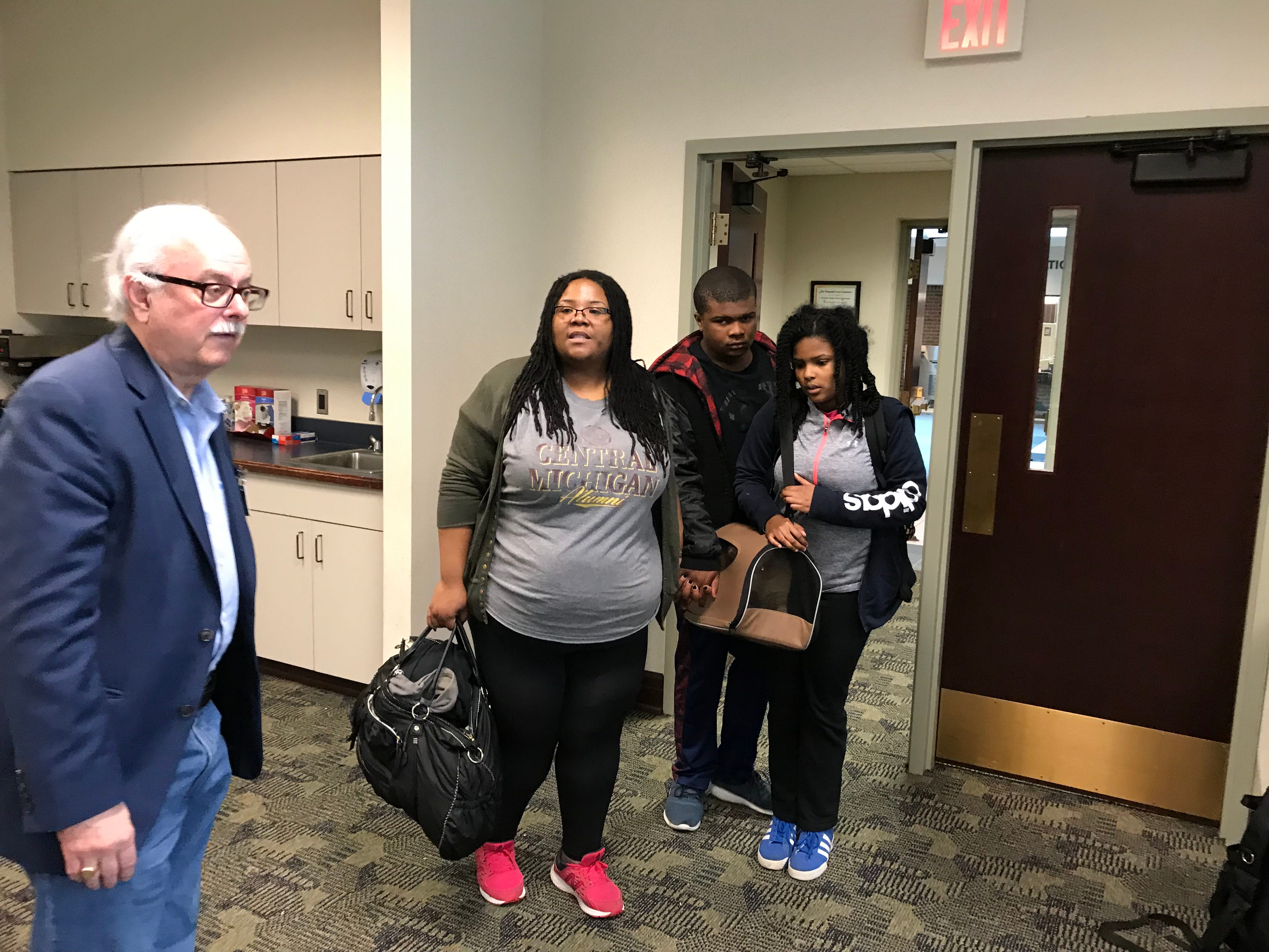Dearborn Heights Mayor Daniel Paletko welcomed Laquae Lebron and her family to the makeshift shelter set up for residents affected by the flood.