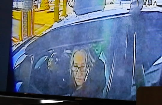 An image of Karen Spranger in her car at an ATM, one of the images shown during a press conference by Macomb County Prosecutors office.