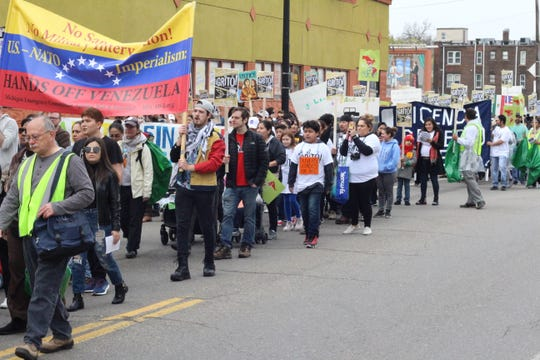 Protesters lead a march down West Vernor in southwest Detroit on May 1 to demand licenses for undocumented immigrants in the state.