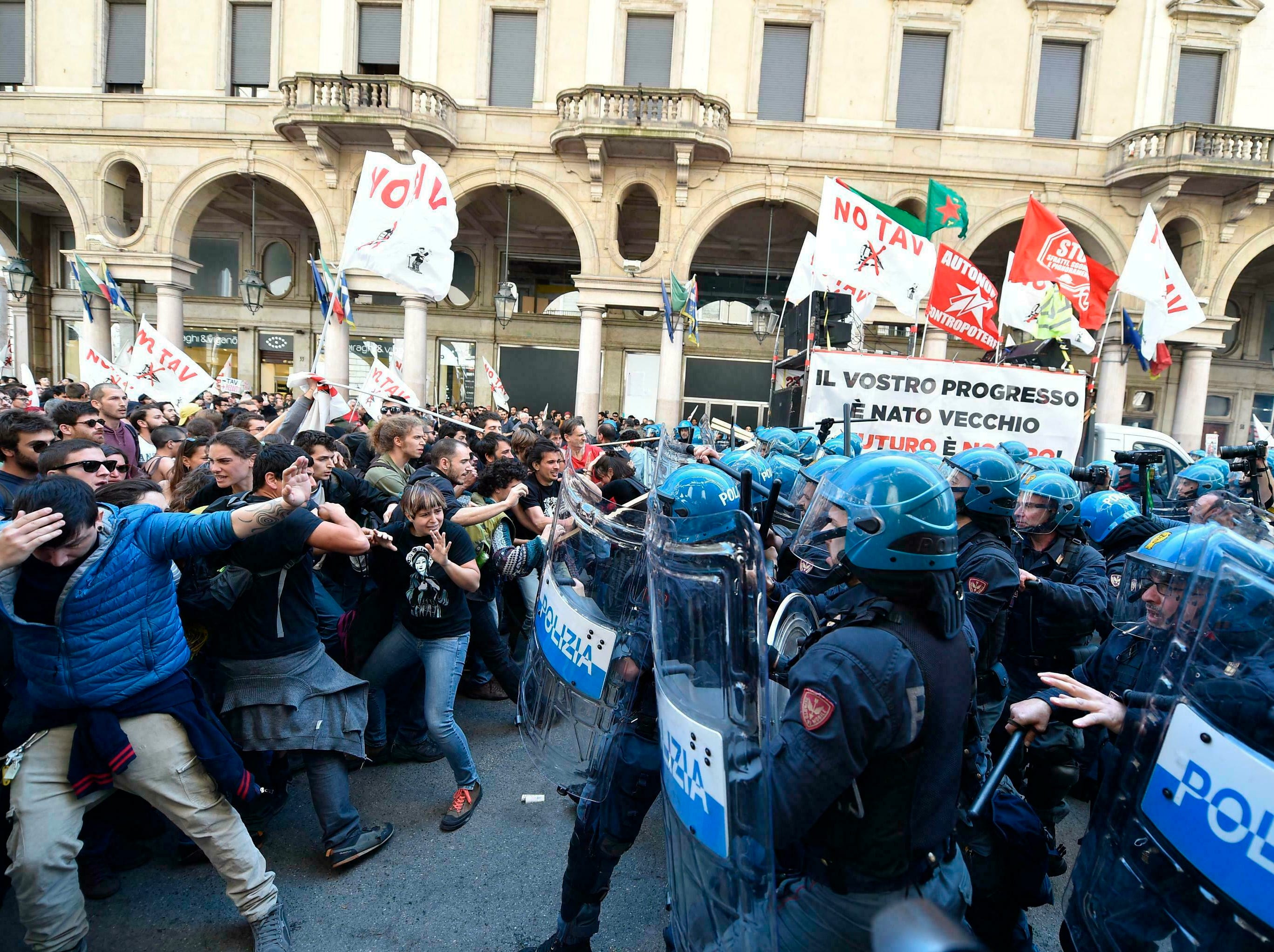 Demonstrators confront police officers as scuffles break out during a May Day rally in Turin, Italy, Wednesday, May 1, 2019.