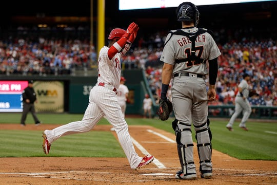 Philadelphia Phillies' Andrew McCutchen runs past Detroit Tigers catcher Grayson Greiner, scoring off of a hit by Rhys Hoskins in the first inning Wednesday. The Phillies won 7-3 to split the two-game interleague series.