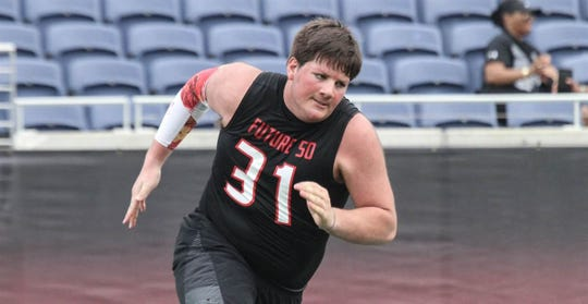 Michigan made the top five for Broken Arrow (Okla.) offensive lineman Andrew Raym, ranked by 247Sports as the No. 1 guard in the country.