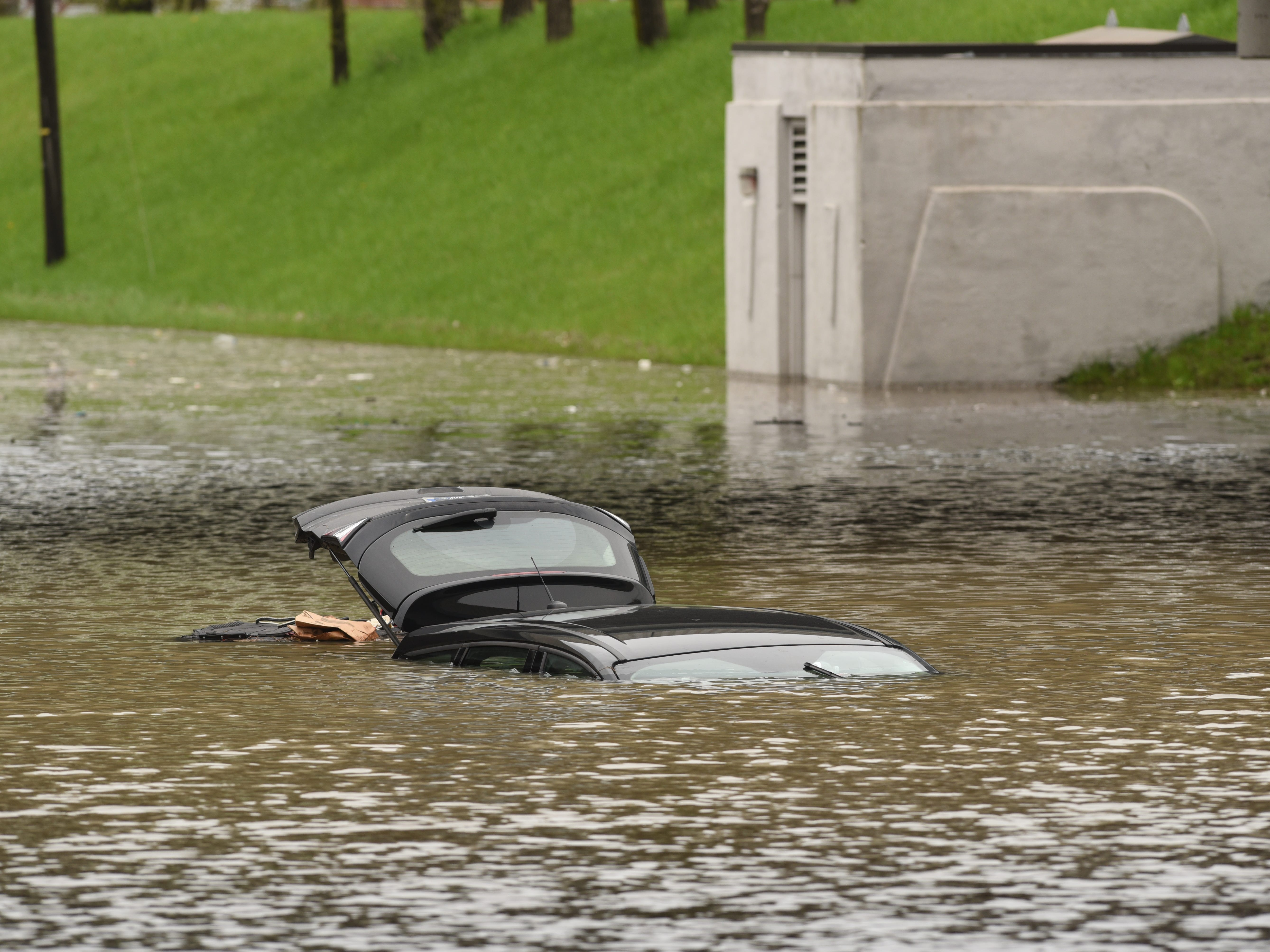 The roof and open hatch are the only visible signs of this submerged car at the Monroe Blvd underpass at the I-94 in Taylor.