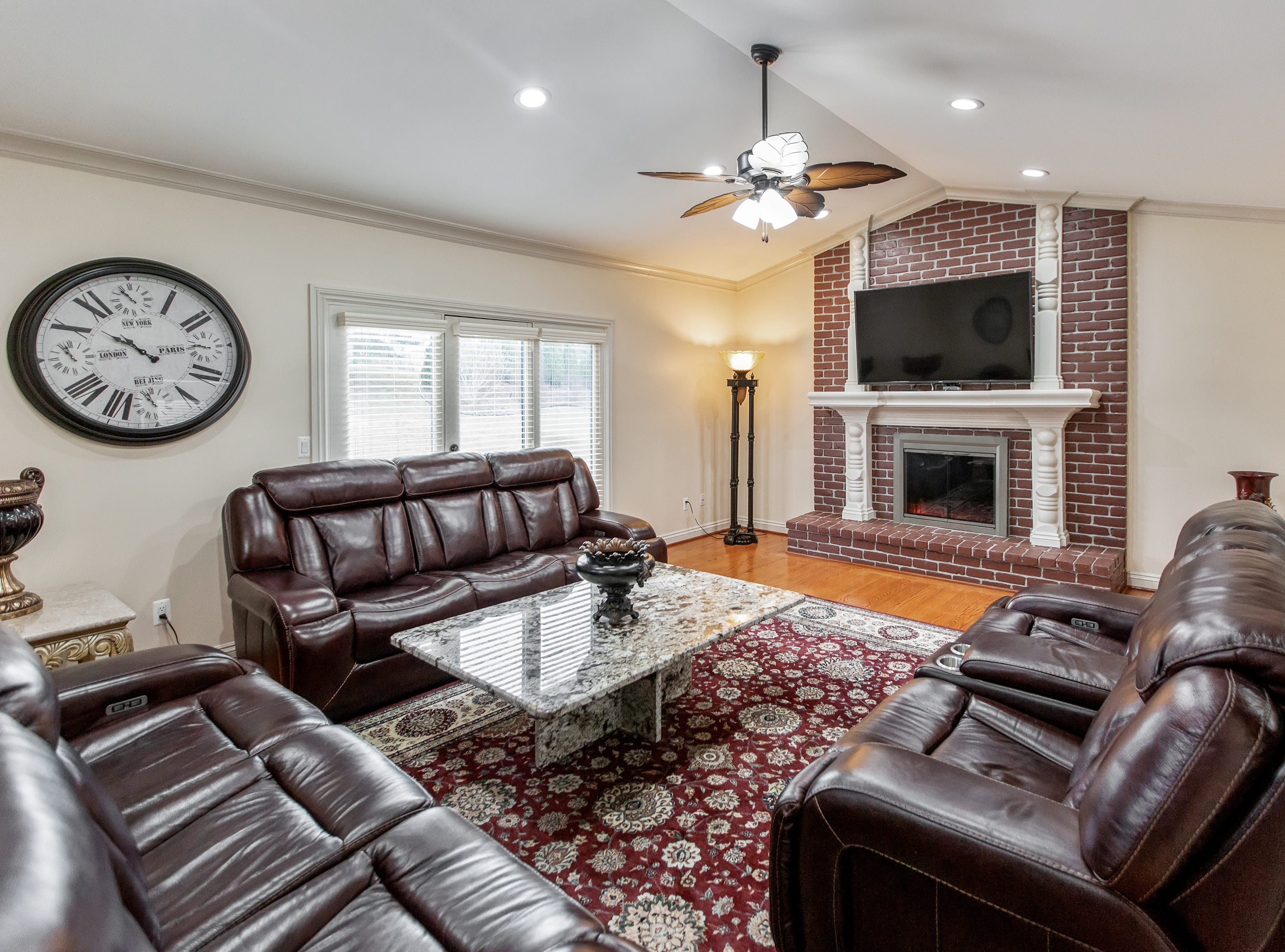 With 2,579 square feet, the two-story house has an open floor plan that flows into a family room with a fireplace that's sure totake the chill away on cold winter nights.