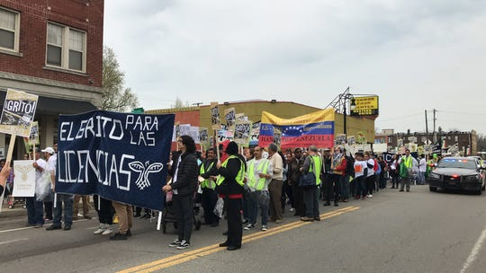 About 150 protesters march on West Vernor in southwest Detroit on May 1 to demand driver's licenses for undocumented immigrants in the state.