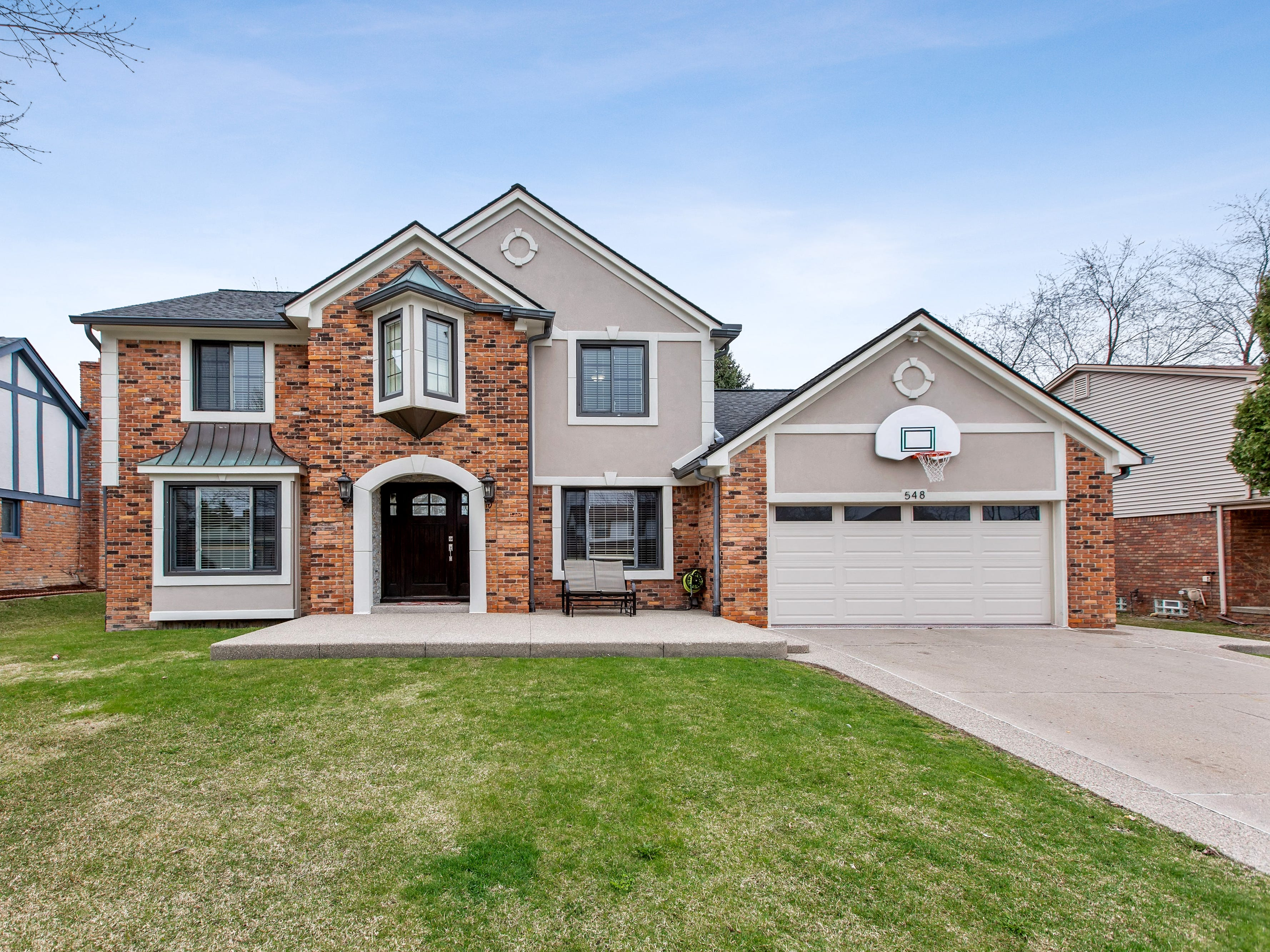 A customized colonial in Rochester Hills, designed with a heated garage that includes a second kitchen, is being offered for sale at $419,900.