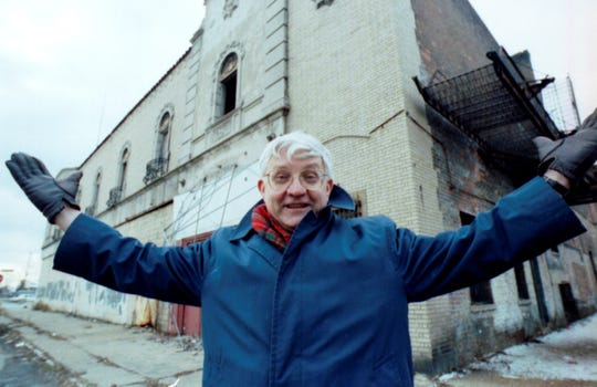 Russ Gibb poses outside the Grande Ballroom in Detroit in 1993.