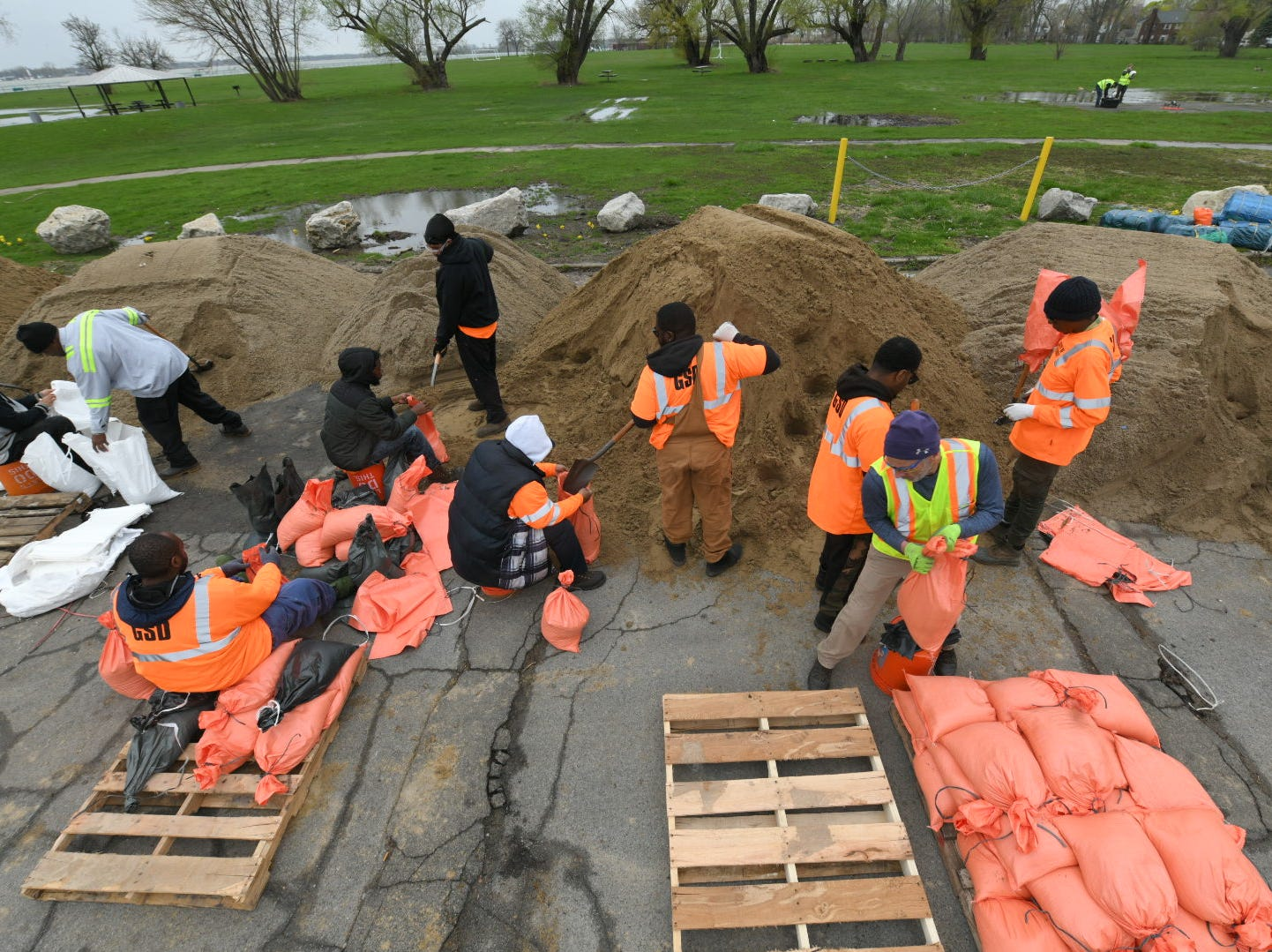 Volunteers and Detroit City workers fill sandbags at Alfred Brush Ford Park, in Detroit, May 1, 2019.