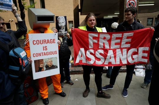 Protesters outside court before Julian Assange appears to be sentenced on charges of jumping British bail seven years ago, in London.