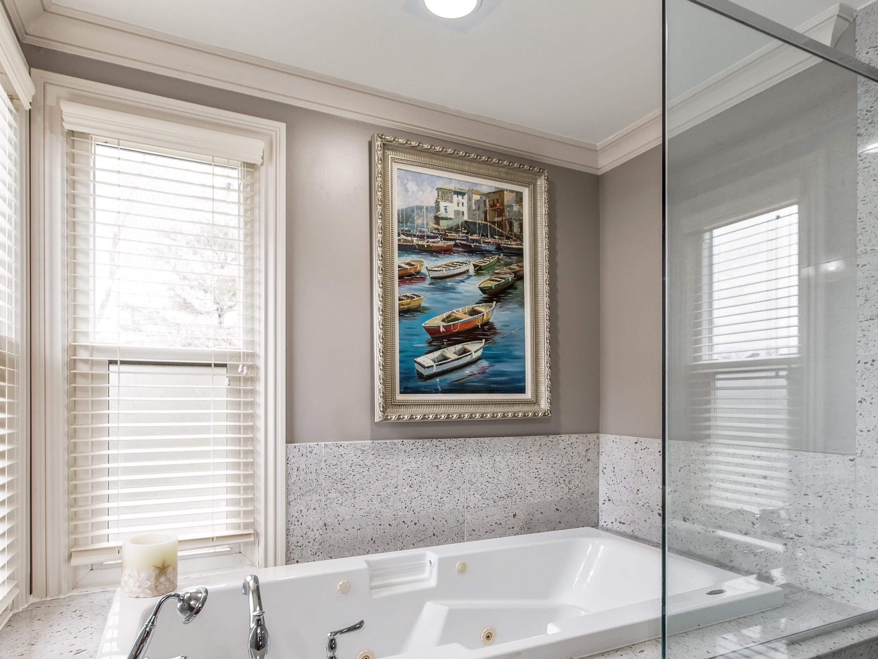 Built in 1985, the house comes with modernized accents, wainscoting, crown moldings, granite countertops, and a large master bedroom en-suite with a jetted tub and granite shower. There are also four additional bedrooms, and a total of 2 ½ baths.