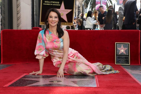 Lucy Liu poses at a ceremony honoring her with a star on the Hollywood Walk of Fame on Wednesday, May 1, 2019, in Los Angeles.