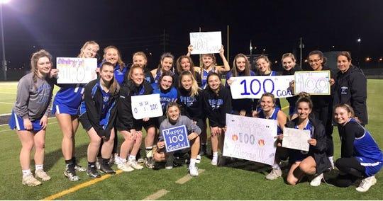Avery Snyder of Horseheads, center, scored her 100th career goal April 30, 2019 against Corning at Corning Memorial Stadium.