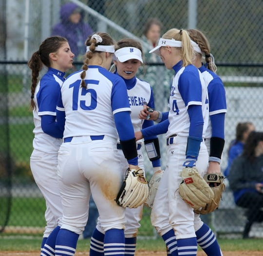 Maddie Rogers, left, huddles with teammates on her way to a no-hitter against Vestal on April 30, 2019 at the Horseheads Middle School field.
