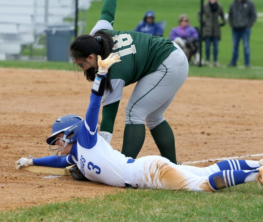 Abby Packard of Horseheads calls for time after safely sliding into third base as Vestal third baseman Emerson Wong applies the tag April 30, 2019 at the Horseheads Middle School field.