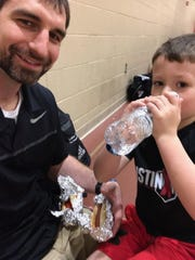 Luke Zeller (left) and his son Kyston had a picnic on the gym floor Sunday as the Adidas Spring Classic came to an end in Indianapolis.