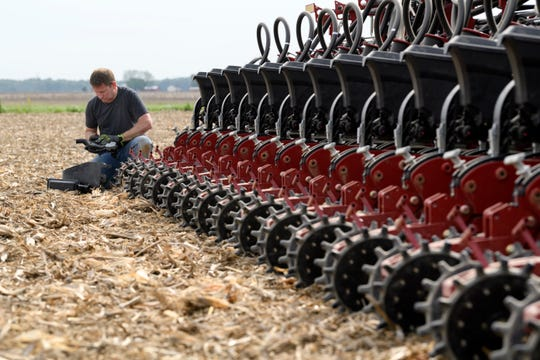Eric Crews of Stahl Farms checks to make sure the farm's new Case IH Early Riser planting machine is working before continuing to plant soybeans on a field along Old Boonville Highway in Evansville, Ind., Wednesday morning, May 1, 2019.