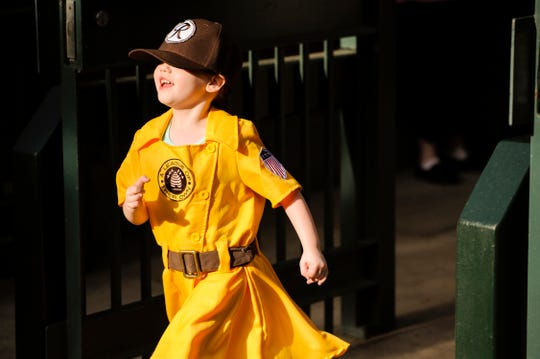 Ella Riddle, 4, of Evansville, wearing A League of Their Own uniform, attends the Otters home opener against Schaumburg at Bosse Field in Evansville, Friday, May 13, 2016.