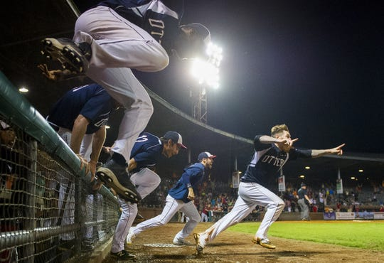 The Evansville Otters rush the field after beating the River City Rascals 1-0 in Game 5 of the 2016 Frontier League Championship Series at Bosse Field in Evansville on Monday, Sept. 19, 2016.