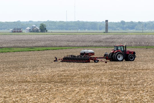 Eric Crews of Stahl Farms checks to make sure the farm's new Case IH Early Riser planting machine is working before continuing to plant soybeans on a field along Old Boonville Highway in Evansville, Ind., Wednesday morning, May 1, 2019. It was the first day the planting machine was put to use.