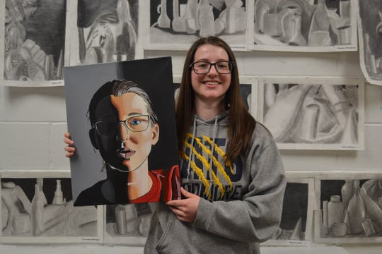 9866  Jordyn Gears holds her self-portrait which took first place in Ohio's Fifth District 2019 Congressional Art Competition. The work was Gears' first attempt using paint.