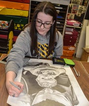 "Jordyn Gears works on a drawing in Jodie Peace's art class at Woodmore High School. Gears credits Peace with much of her artistic success, saying the class has ""done everything"" for her."