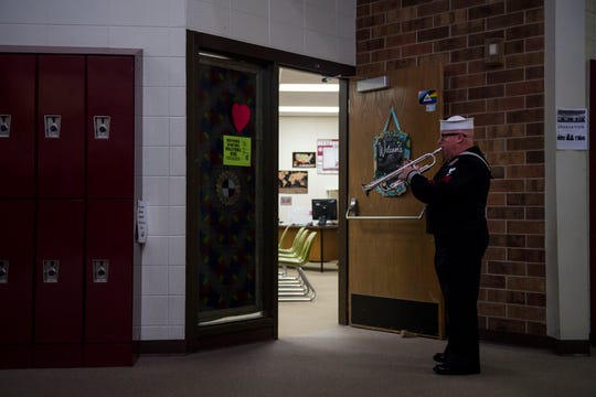 Mark Stallins, U.S. Navy retired, practices his trumpet in the hallway before playing at the chartering ceremony of the new Berthoud VFW Post 12189 - SPC Gabriel Conde Memorial on Tuesday, April 30, 2019, at Berthoud High School in Berthoud, Colo.