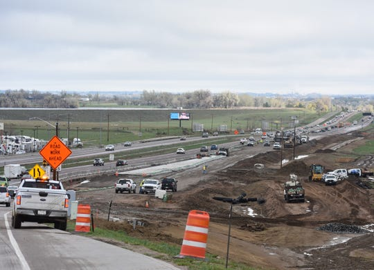 Road crews work on adding a lane on Interstate 25 just north of Colorado Highway 392 on Wednesday.