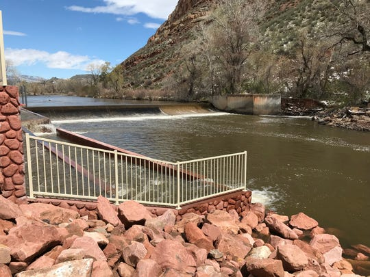 A fish ladder is shown to the left of the Watson Lake dam on the Poudre River in Bellvue.
